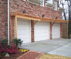 even brick garages can benefit from a pergola built into them