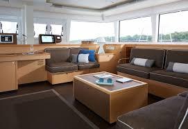 the cabin of a catamaran boat featuring blue cushions made using sunbrella fabrics