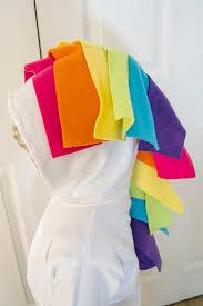 use fleece strips to make a unicorn mane and tail on a diy unicorn hoo costume