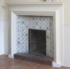 bathroom fireplace at owletts gravesend kent with garrard dutch tiles flower vases and bird designs