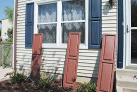 i worked on painting the trim around the front door while justin worked on the shutters it was when the shutters went back up that we realized we had a