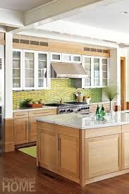 Kitchen With Glass Tile Backsplash Stunning Brushedaluminum Upper Cabinets Add A Modern Touch To The Kitchen