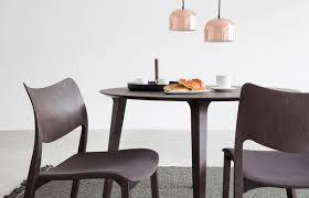 laclasica chair with upholstered seat around a grey lau table
