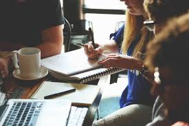 photo of teens writing