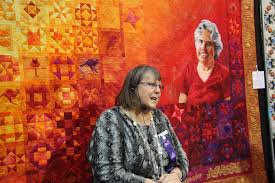 Suzanne Gummow & Jenny Bowker in front of her quilt