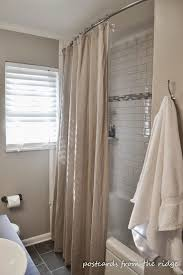 curved shower curtain rod with tan curtain and white bath up plus white window with blinds