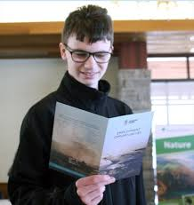 trevor smith from niagara falls checks out a brouchure deling some of the seasonal jobs available with niagara parks during the niagara parks summer