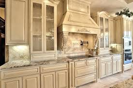 kitchen cabinet view larger image kitchen with wood vent hood and glass panel cabinet doors in paint grade maple kitchen cabinet hardware