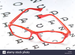 A Pair Of Red Reading Glasses Or Spectacles On An Snellen