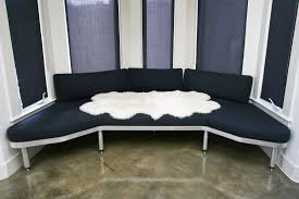 relaxing furniture. Furniture. Dark Blue Fabric Window Seat With 4 White Legs On The Mocha Tile Floor Relaxing Furniture S