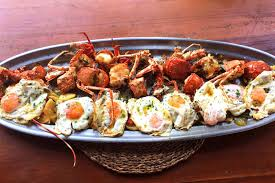Lobster with fried eggs and Ibiza potatoes