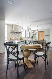 black dining chairs with light table