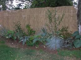 change the look of a chain link fence by adding flexible inserts into the links in a color that blends with your landscaping
