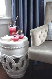 now i realize not everyone has a corner nook with a chair and side table in their dining room but you can still use a garden stool to hold drinks snacks