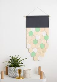 i chose to use white and a minty green sparingly in my wall hanging to create little pops of colour the top part of the hanging is made from a s of