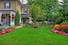 victorian cottage with curved flower beds