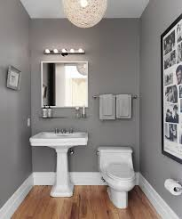 powder room with steel gray walls and white twine pendant over oak hardwood  floors - ideas and inspiration for redesign your home and bathroom mid  century ...