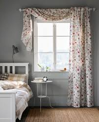 curtains for bedroom windows with designs. Brilliant Designs A Floralprinted Curtain Hangs In A Window Bedroom In Curtains For Bedroom Windows With Designs