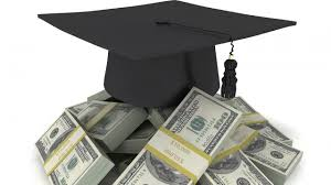 is roi the only thing that matters while selecting mba colleges a graduation cap placed on a pile of money symbolic of the importance given to roi