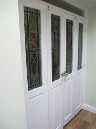 still available pair of internal bifold doors room dividers with lead effect stained glass