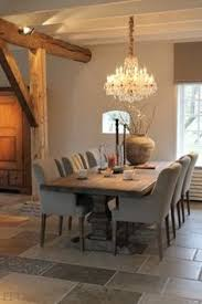 putty upholstered dining chairs and gorgeous taupe walls belgian style katherine barnett broker
