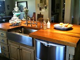 face grain reclaimed longleaf pine island top with farm sink and waterlox finish