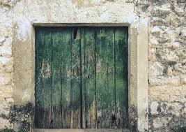 old wooden door with green patina