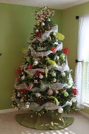 decorated christmas trees with mesh ribbon