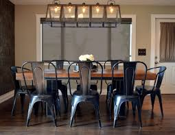 farmhouse kitchen industrial pendant. Industrial Farmhouse Kitchen Interior Design, Reclaimed Wood And Metal Table, Long Pendant With Warm Patina, Dining Chairs.