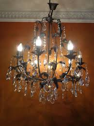 solid crystal chandelier black metal eight light points second half of 20th century
