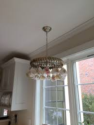 upcycled home accent a vintage spoon chandelier