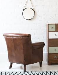 classic leather armchair at rose and grey brown leather armchair