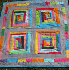I like the sashing & borders, and the all solid quilt. Ellison ... & Rainbow Cabins by Ellison Lane Quilts - a lovely quilt Adamdwight.com