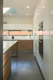 Horizontal windows and a skylight contribute to making the kitchen bright.
