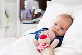 when can babies use blankets pillows