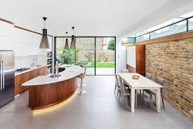 Large trendy galley eat-in kitchen photo in London with an undermount sink,  flat