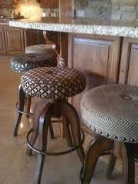 like the mixing of patterns on barstools mix patterns fabric