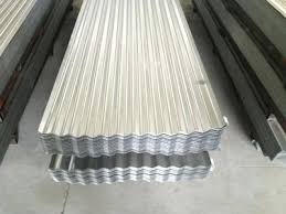 galvanized tin roofing there are two piles of galvanized corrugated roofing sheets they all have eleven