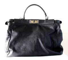 this incredible black leather handbag is from fendi and features their stylish kaboo design this