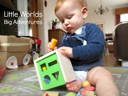 Heuristic Play Toy Posting, a Fine Motor Game for Babies - Little Worlds