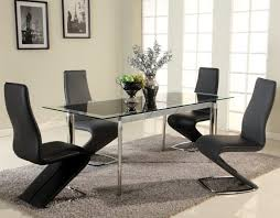 black glass extendable dining set with four zig zag chairs