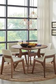 have no reservations about this dining set that s timeless and trendy the florence round table walnut