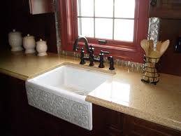 a sinks in modern kitchen with countertop and window