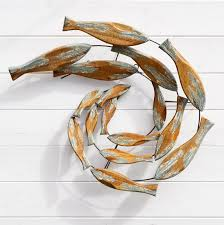 wooden shoal of fish wall art
