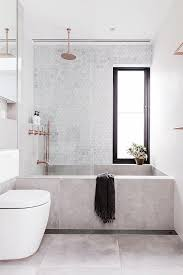 concrete bathtub and tile backsplash in modern sydney bathroom via