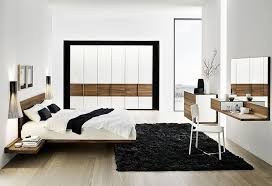 black bedroom rug. A Modern Bedroom With Black Wool Area Rug Vanity Integrated Frameless Mirror