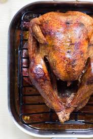 the turkey should be placed in a shallow pan in order to expose as much skin as possible to the heat and produce more super cri skin in the process