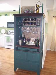 best 25 armoire bar ideas on liquor cabinet armoires and jake paul white house