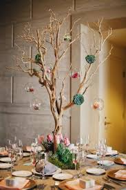 manzanita branch centerpiece with succulents and hanging ball vases (for  the ceremony table?)