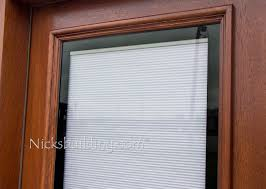 shades between glass wood doors blinds